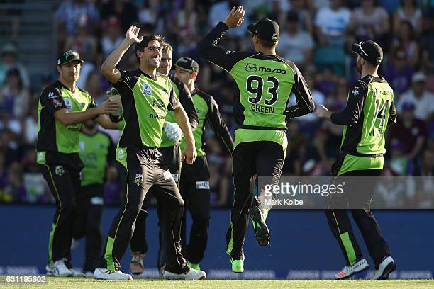 Pat Cummins of the Thunder celebrates taking the wicket of D'Arcy Short of the Hurricanes during the Big Bash League match between the Hobart...