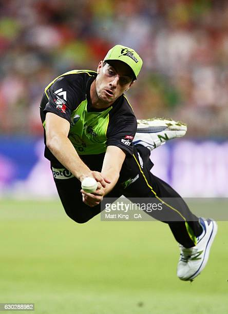 Pat Cummins of the Thunder drops a chance to catch Moises Henriques of the Sixers during the Big Bash League match between the Sydney Thunder and the...