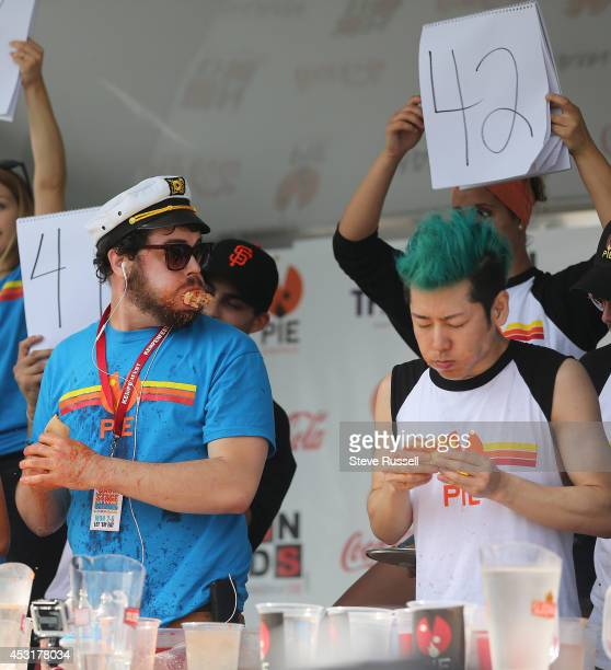 BARRIE ON AUGUST 4 Pat 'Deep Dish' Bertoletti from Chicago looks over at Takeru Kobayashi's number of slices Kobayashi defended his pizza eating...