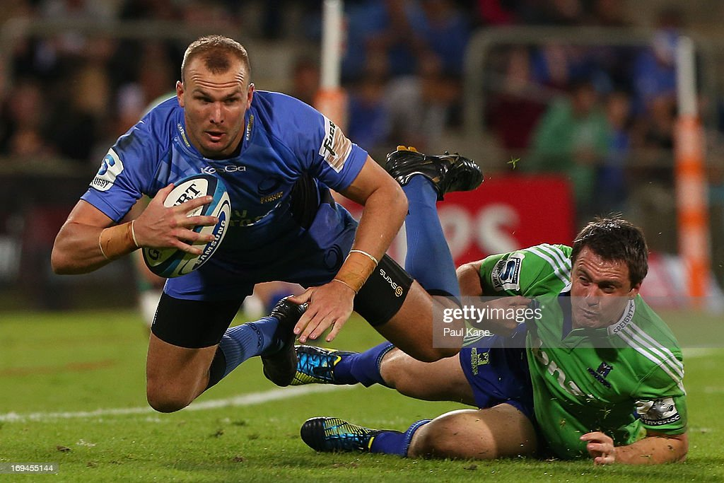 Pat Dellit of the Force gets tackled by Ben Smith of the Highlanders during the round 15 Super Rugby match between the Western Force and the Highlanders at nib Stadium on May 25, 2013 in Perth, Australia.