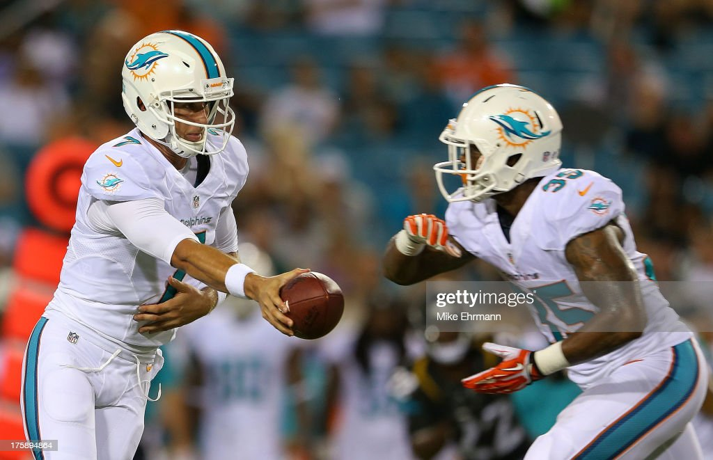 Pat Devlin #7 of the Miami Dolphins hands off to <a gi-track='captionPersonalityLinkClicked' href=/galleries/search?phrase=Mike+Gillislee&family=editorial&specificpeople=7128731 ng-click='$event.stopPropagation()'>Mike Gillislee</a> #35 during a preseason game against the Jacksonville Jaguars at EverBank Field on August 9, 2013 in Jacksonville, Florida.