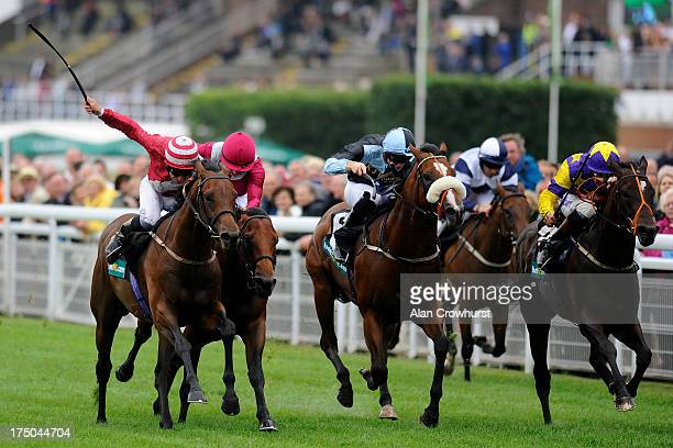 Pat Dobbs riding Brown Sugar win The bet365 Molecomb Stakes at Goodwood racecourse on July 30 2013 in Chichester England