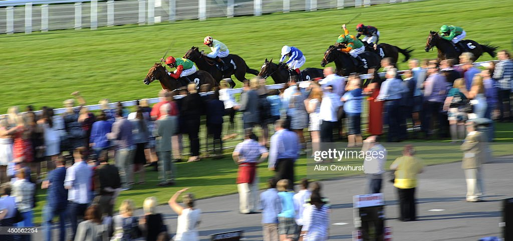 Pat Dobbs riding Step To The Shears win The Three Friday Nights Maiden Auction Stakes at Goodwood racecourse on June 13, 2014 in Chichester, England.