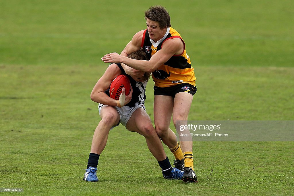 Pat Dowling of the Geelong Falcons (L) is tackled by Reece Piper of the Dandenong Stingrays during the round eight TAC Cup match between Dandenong Stingrays and Geelong Falcons at Shepley Oval on May 29, 2016 in Melbourne, Australia.
