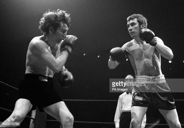 Pat Dwyer and Alan Minter in action during their middleweight boxing contest at the Royal Albert Hall in London Minter won on points