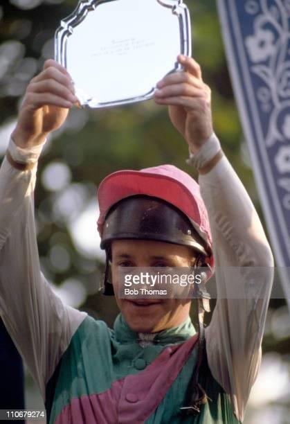 Pat Eddery holds aloft the trophy after winning the Prix de l'Arc de Triomphe on Dancing Brave at Longchamp on 5th October 1986