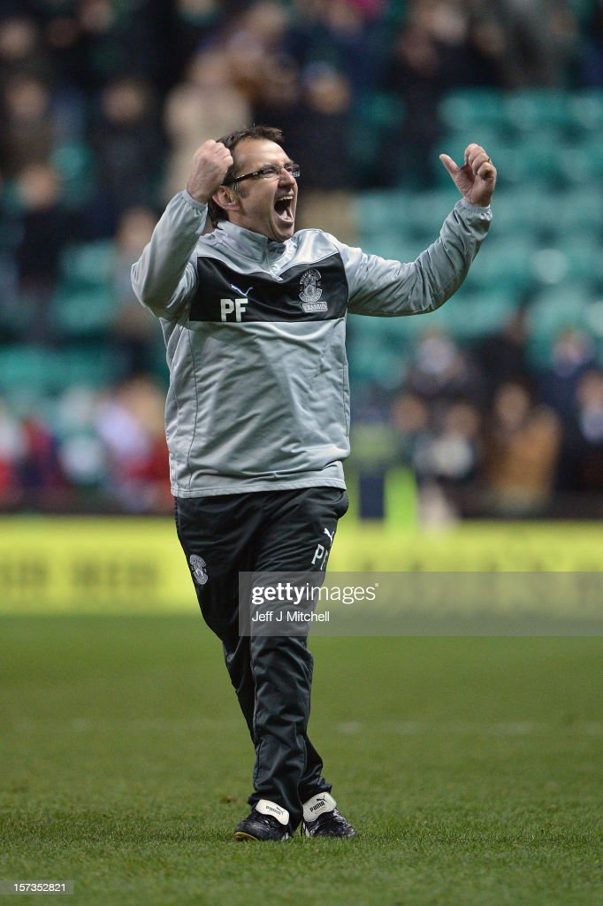 Pat Fenlon coach of Hibernian celebrates his team's win against Hearts in the Scottish Cup match between Hibernian and Hearts at Easter Road Stadium on December 2, 2012 in Edinburgh,Scotland.
