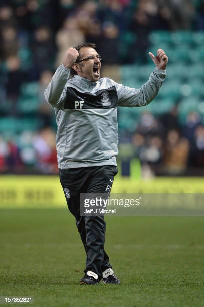 Pat Fenlon coach of Hibernian celebrates his team's win against Hearts in the Scottish Cup match between Hibernian and Hearts at Easter Road Stadium...