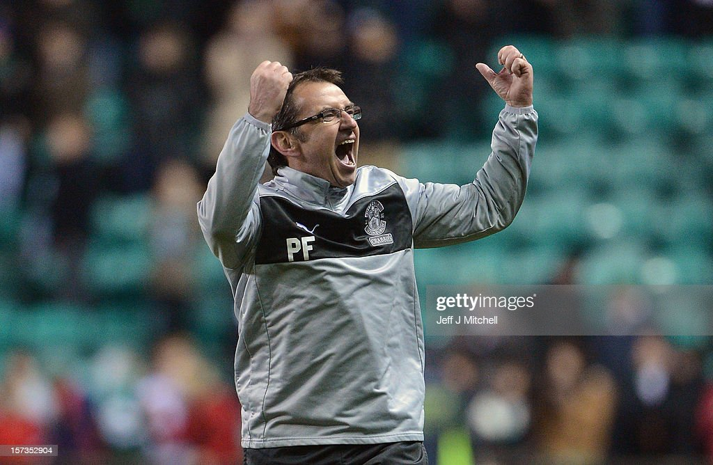 Pat Fenlon coach of Hibernian celebrates his teams win against Hearts in the Scottish Cup match between Hibernian and Hearts at Easter Road Stadium on December 2, 2012 in Edinburgh,Scotland.