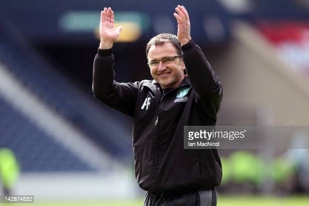 Pat Fenlon manager of Hibernian celebrates victory at the final whistle during The William Hill Scottish Cup Semi Final between Aberdeen and...