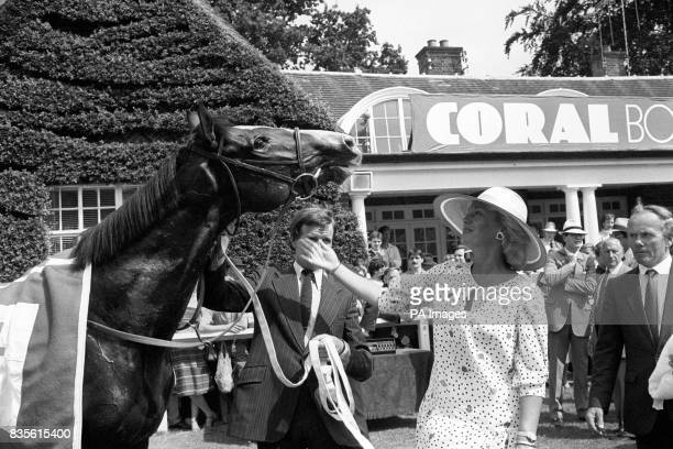 A pat for Sadler's Wells after winning the CoralEclipse Stakes at Sandown Park from Susan Sangster wife of the horse's owner Robert Sangster