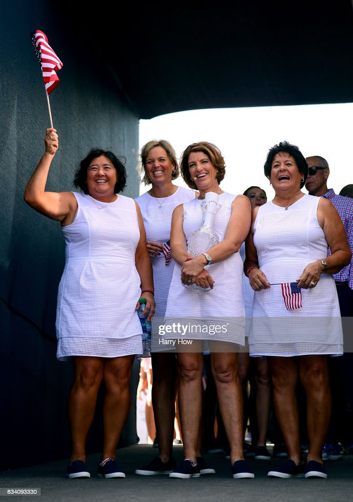 Pat Hurst, Wendy Ward, Juli Inkster, and Nancy Lopez of Team USA smile in the tunnel before they are introduced to the crowd during opening ceremony for the Solheim Cup at the Des Moines Golf and Country Club on August 17, 2017 in West Des Moines, Iowa.