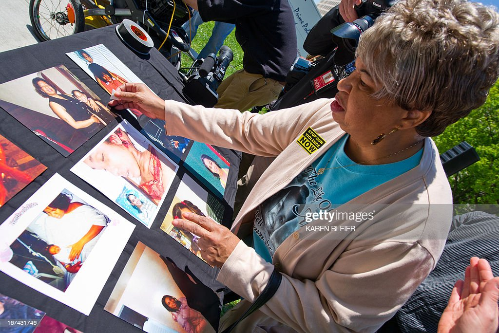Pat Jeffries, a..k.a 'Nana' displays pictures of her granddaughter, during an rally against the National Rifle Association (NRA) on April 25, 2013 in Washington, DC. Jeffries granddaughter, Brishell Jones was killed in 2010 in a drive-by shooting. The NRA is lobbying against gun reforms laws being debated in the US Congress. AFP PHOTO/Karen BLEIER