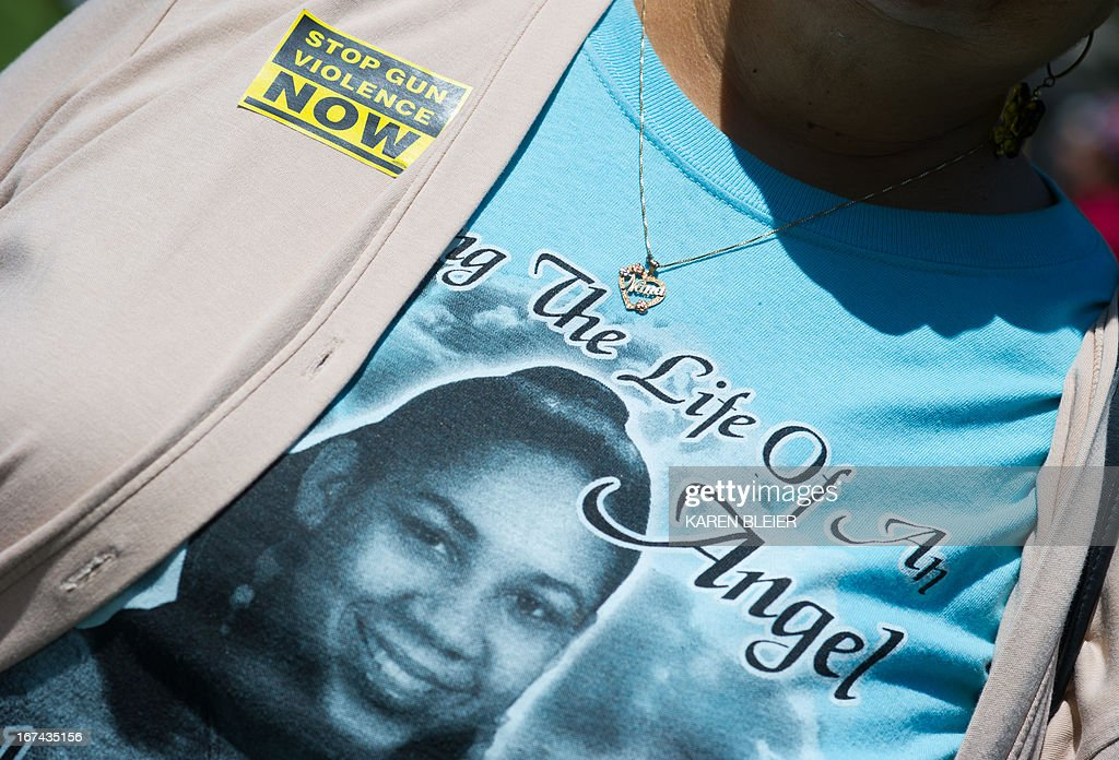 Pat Jeffries, wears a t-shirt with a picture of her granddaughter Brishell and a necklace that says 'Nana' given to her the young girl, during an anti-NRA(National Rifle Association) rally April 25, 2013 in Washington, DC. Jeffries granddaughter, Brishell Jones was killed in 2010 in a drive-by shooting. AFP PHOTO/Karen BLEIER