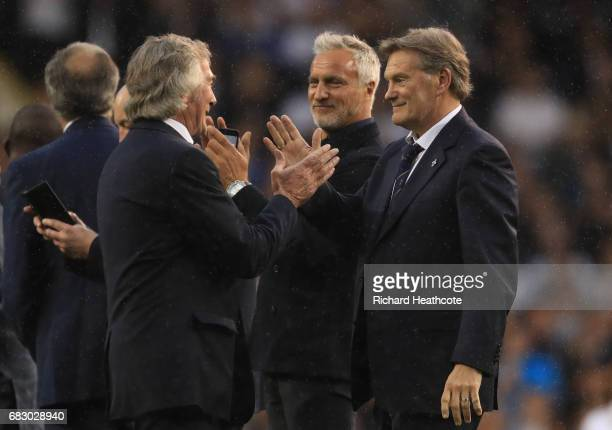 Pat Jennings David Ginola and Glenn Hoddle stand on the pitch during the closing ceremony after the Premier League match between Tottenham Hotspur...