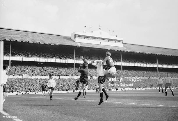 Pat Jennings Laurie Brown and Denis Law pictured during a match between Tottenham Hotspur and Manchester United October 1965