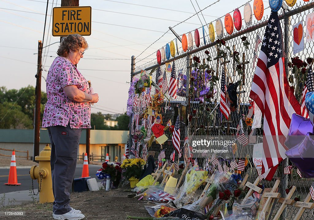 Pat Jines of Chino Valley, Arizona looks over the makeshift memorial outside of Station 7 on July 3, 2013 in Prescott, Arizona. Nineteen firefighters based out of Station 7 died battling a fast-moving wildfire near Yarnell, Arizona on June 30. Station 7 has been the home of the Granite Mountain Interagency Hotshot Crew since 2010.