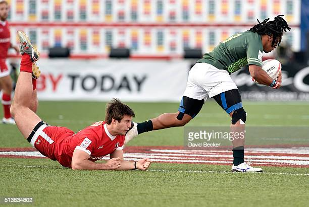 Pat Kay of Canada misses a tackle against Rosko Specman of South Africa during the USA Sevens Rugby tournament at Sam Boyd Stadium on March 4 2016 in...