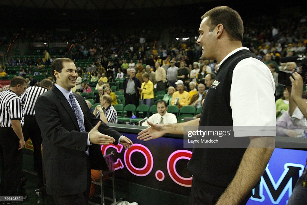 Pat Knight head coach of the University of Texas Tech Red Raiders basketball team has a pregame handshake with Scott Drew head coach of the...