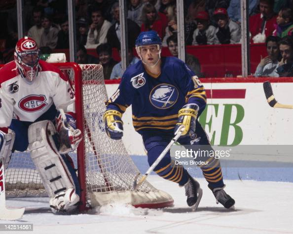 Pat Lafontaine of the Buffalo Sabres skates past Patrick Roy of the Montreal Canadiens Circa 1990 at the Montreal Forum in Montreal Quebec Canada