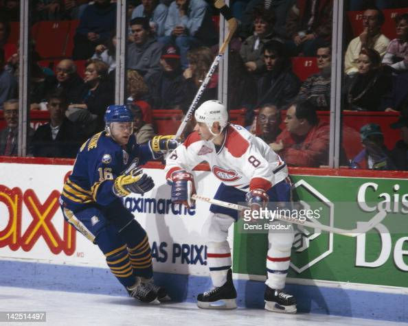 Pat Lafontaine of the Buffalo Sabres skates past Ronald Wilson of the Montreal Canadiens at the Montreal Forum in Montreal Quebec Canada