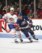 Pat Lafontaine of the New York Islanders skates against Mathieu Schneider of the Montreal Canadiens Circa 1980 at the Montreal Forum in Montreal...