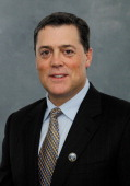 Pat LaFontaine poses for his official headshot after being named President of Hockey Operations of the Buffalo Sabres on November 13 2013 at the...