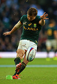 Pat Lambie of South Africa kicks a conversion during the QBE Intenational match between England and South Africa at Twickenham Stadium on November 15...