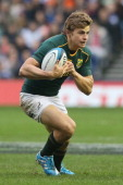 Pat Lambie of South Africa runs with the ball during the International match between Scotland and South Africa at Murrayfield Stadium on November 17...