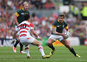 Pat Lambie of South Africa takes on Kosei Ono of Japan during the 2015 Rugby World Cup Pool B match between South Africa and Japan at Brighton...