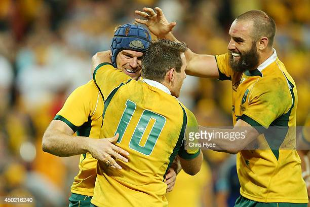 Pat McCabe of the Wallabies celebrates with Bernard Foley and Scott Fardy after scoring a try during the First International Test Match between the...