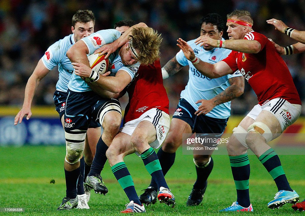 Pat McCutcheon of the Waratahs runs the ball during the match between the NSW Waratahs and the British & Irish Lions at Allianz Stadium on June 15, 2013 in Sydney, Australia.