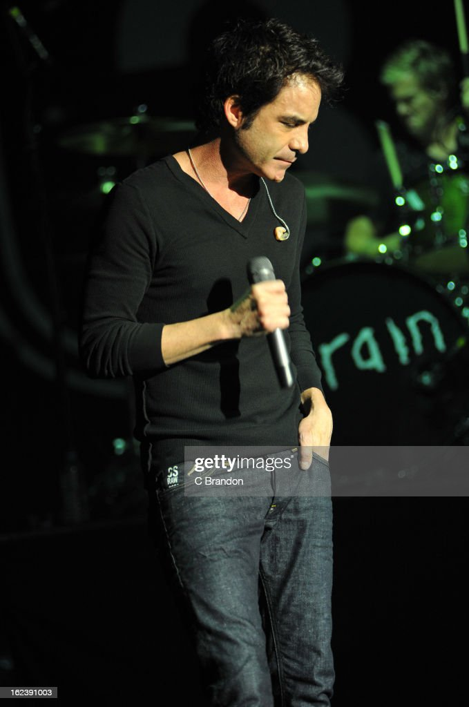 Pat Monahan and Scott Underwood of Train perform on stage at Hammersmith Apollo on February 22, 2013 in London, England.