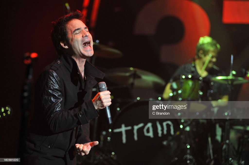 Pat Monahan and <a gi-track='captionPersonalityLinkClicked' href=/galleries/search?phrase=Scott+Underwood&family=editorial&specificpeople=857287 ng-click='$event.stopPropagation()'>Scott Underwood</a> of Train perform on stage at Hammersmith Apollo on February 22, 2013 in London, England.