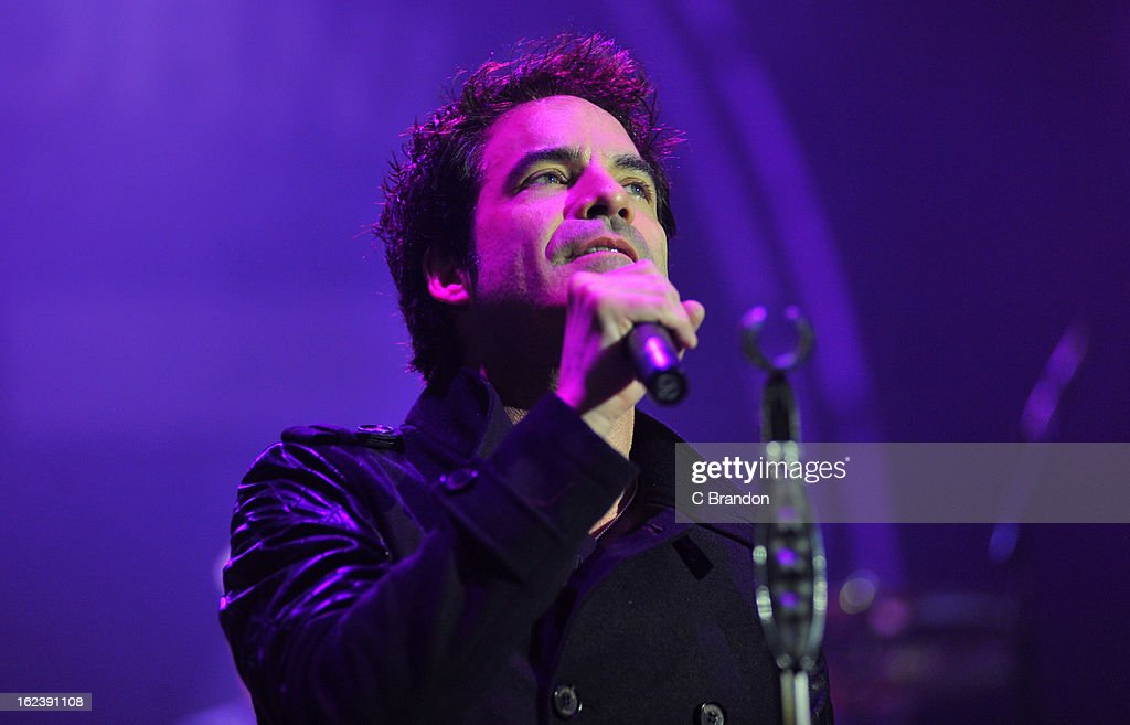 Pat Monahan of Train performs on stage at Hammersmith Apollo on February 22, 2013 in London, England.