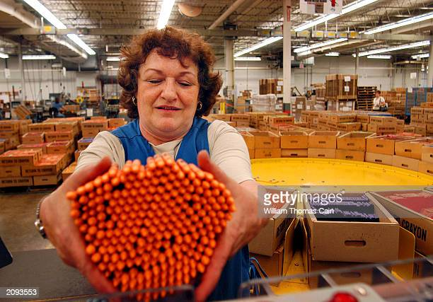 Pat Muschlitz places crayons into a packaging machine at Binney and Smith Inc the manufacturer of Crayola crayons June 18 2003 in Easton Pennsylvania...
