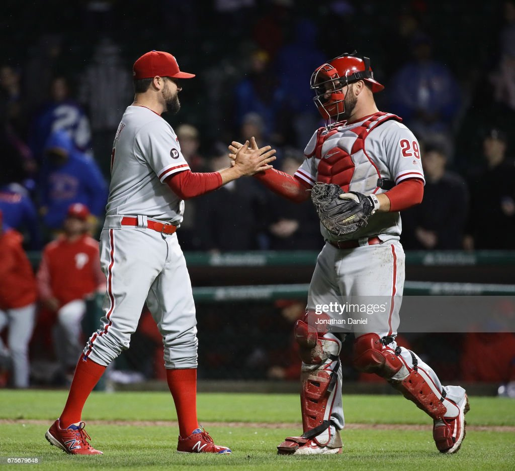 Pat Neshek #17 (L) and Cameron Rupp #29 of the Philadelphia Phillies celebrateawin over the Chicago Cubs at Wrigley Field on May1, 2017 in Chicago, Illinois. The Phillies defeated the Cubs 10-2.