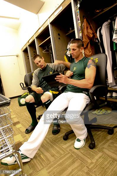 Pat Neshek and Grant Balfour of the Oakland Athletics relax in the clubhouse prior to the game against the Seattle Mariners at Oco Coliseum on August...