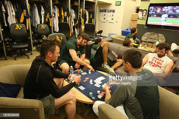 Pat NeshekJosh Donaldson and Eric Sogard of the Oakland Athletics play poker in the clubhouse while Derek Norris and Chris Young play with their...