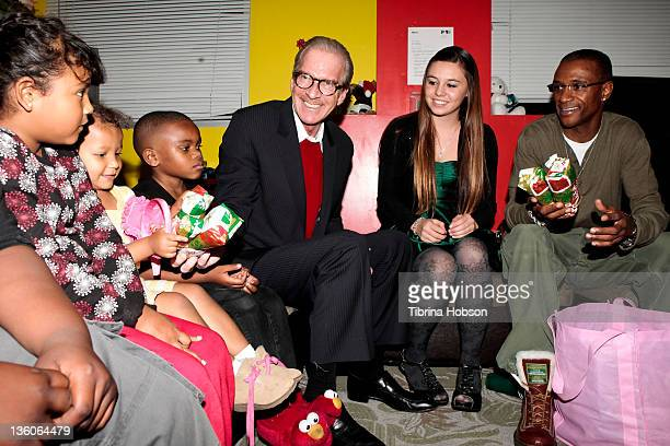 Pat O'Brien Haily Helton and Tommy Davidson pass out Christmas gifts to the children at PATH Partners' Annual Celebrity Holiday Party on December 21...