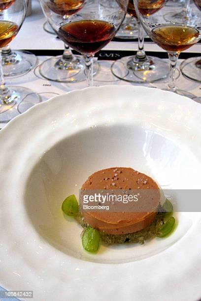 A pat of foie gras terrine is served to match with Maison Cazes' sweet Rivesaltes wines at The Modern restaurant in New York US on Wednesday Feb 27...