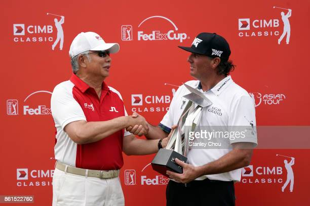 Pat Perez of the United States receives the CIMB Classic trophy from the Prime Mister of Malaysia Dato Seri Mohd Najib Tun Razak after the final...