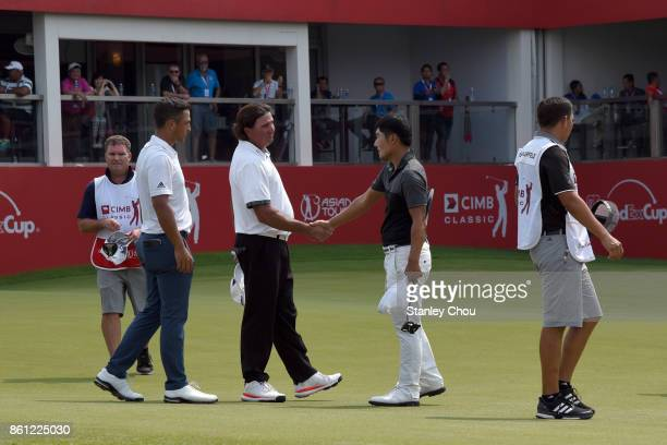 Pat Perez of the United States shakes hands with Kang Sung of South Korea while Xander Schauffele of United States looks on during round three of the...