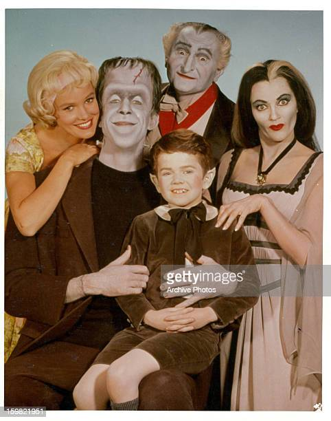 Pat Priest Al Lewis and Butch Patrick along with Fred Gwynne and Yvonne De Carlo of the Munster family in a publicity photograph from the television...