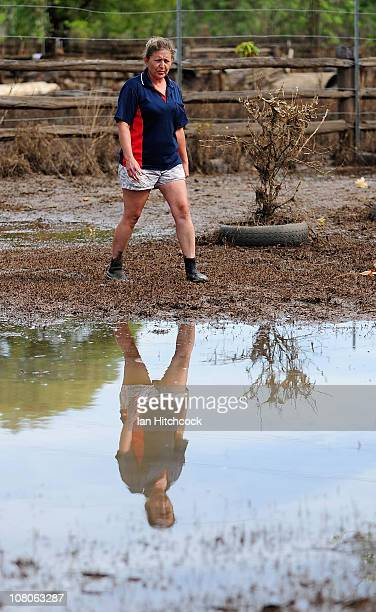 Pat Proefke surveys her backyard after flood waters fall on January 16 2011 in Rockhampton Australia Rockampton experienced some of Queensland's...