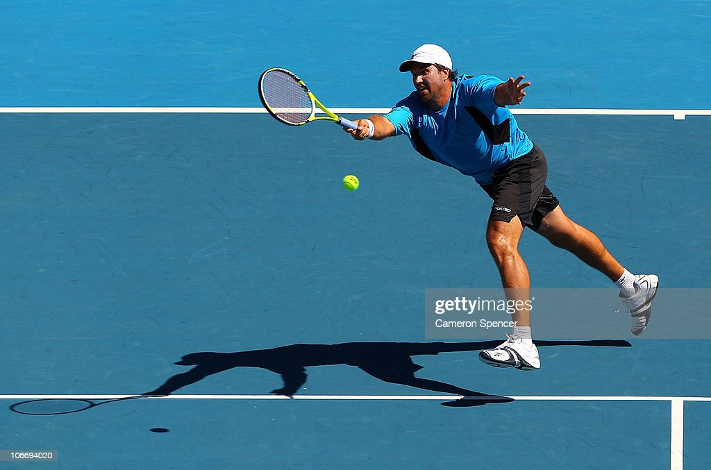 Pat Rafter of Australia plays a forehand during his match against Henri Leconte of France during day one of the Champions Downunder at Sydney Olympic Park Tennis Centre on November 11, 2010 in Sydney, Australia. (Photo by Cameron Spencer/Getty Images for Champions Downunder) champ_1111