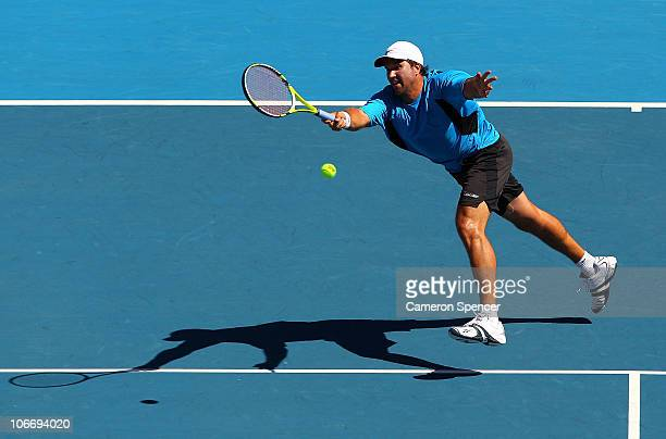 Pat Rafter of Australia plays a forehand during his match against Henri Leconte of France during day one of the Champions Downunder at Sydney Olympic...