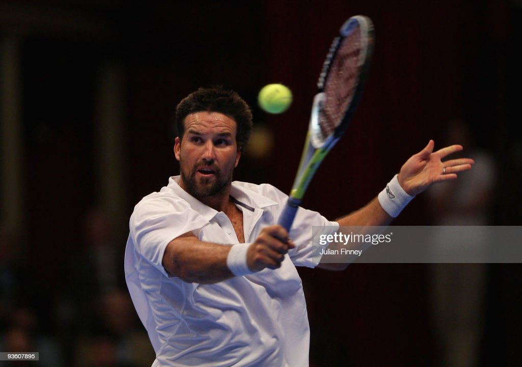 Pat Rafter of Australia plays a volley in his match against Cedric Pioline of France during day two of the AEGON Masters Tennis at the Royal Albert Hall on December 2, 2009 in London, England.