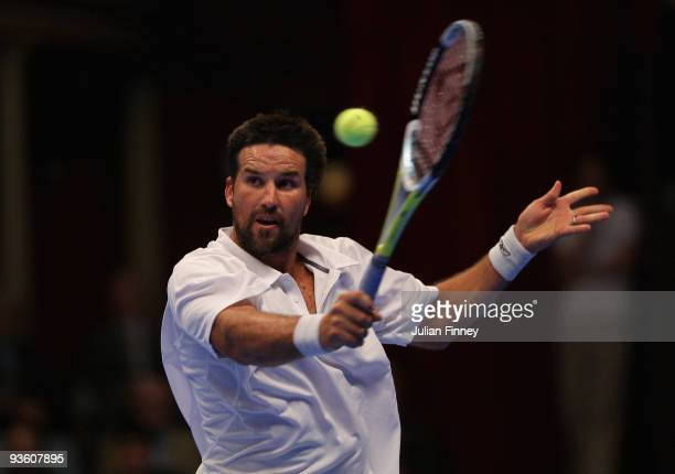Pat Rafter of Australia plays a volley in his match against Cedric Pioline of France during day two of the AEGON Masters Tennis at the Royal Albert...