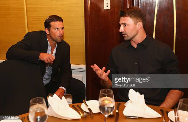 Pat Rafter of the Singapore Slammers talks with Goran Ivanisevic of the UAE Royals at the IPTL gala dinner prior to the start of the CocaCola...